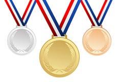 Reeks goud, zilver en brons lege toekenningsmedailles met linten Stock Foto
