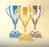 Reeks gouden, brons en zilveren Trofeekoppen of drinkbekers op geweven achtergrond Realistische vectorillustratie royalty-vrije illustratie