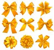 Reeks gouden giftbogen met linten. Stock Afbeeldingen