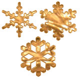 Reeks gouden metaaleffect sneeuwvlokken over wit Royalty-vrije Stock Fotografie