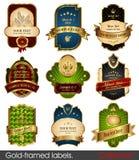Reeks gouden-ontworpen etiketten Stock Afbeeldingen