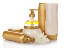 Reeks gouden verschillende flessen voor schoonheid Royalty-vrije Stock Foto's