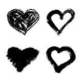 Reeks hand getrokken die grunge harten op witte achtergrond wordt geïsoleerd Royalty-vrije Stock Foto