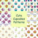 Reeks hans getrokken vector naadloze patronen met cupcakes Royalty-vrije Stock Foto's