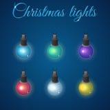 Reeks het gloeien Kerstmislichten Stock Afbeelding