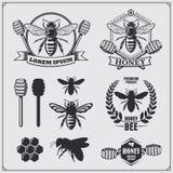 Reeks honingsetiketten, kentekens en ontwerpelementen E stock illustratie
