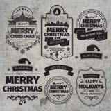 Reeks Kerstmis en Gelukkige Nieuwjaaretiketten met retro wijnoogst gestileerd ontwerp Stock Fotografie