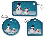 Reeks Kerstmisbellen, stickers, etiketten. met sneeuwman Stock Afbeeldingen