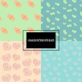 Reeks kleurrijke naadloze patronen met harten Stock Afbeelding