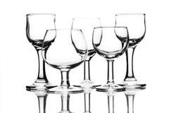 Reeks lege glazen op wit Stock Afbeelding