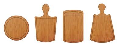 Reeks lege houten scherpe die raad en hakborden op witte achtergrond wordt geïsoleerd Reeks hulpmiddelen om te koken Royalty-vrije Stock Foto