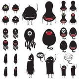 Reeks leuke kleine zwarte monsters stock foto's
