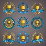 Reeks luxe gouden koppen Stock Afbeelding