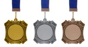 Reeks medailles Stock Foto's
