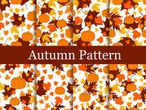 Reeks naadloze patronen van de herfstthema's Vergeelde bladeren en pompoenen Thanksgiving day De achtergrond van de herfst Rode e stock illustratie