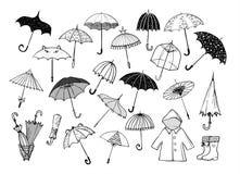 Reeks paraplu's van de krabbelschets op witte achtergrond royalty-vrije illustratie