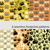 Reeks patronen met voetafdrukken en beenderen Stock Fotografie