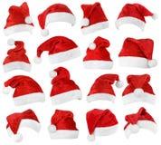 Reeks rode hoeden van Santa Claus Stock Fotografie
