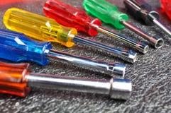 Reeks schroevedraaiers, dopsleuteltoolbox, Handhulpmiddelen Stock Foto's