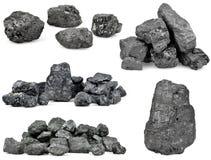 Reeks stapels van steenkool op wit Stock Foto