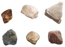 Reeks stenen op witte achtergrond wordt geïsoleerd die Royalty-vrije Stock Afbeelding