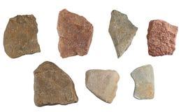 Reeks stenen op witte achtergrond wordt geïsoleerd die Royalty-vrije Stock Foto