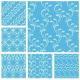 Reeks stoffentexturen in lichtblauwe kleur-naadloze patronen Stock Afbeeldingen
