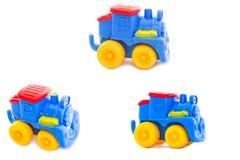 Reeks. Stuk speelgoed een plastic kinderdagverblijf, een stoomlocomotief Royalty-vrije Stock Afbeeldingen