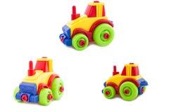 Reeks. Stuk speelgoed een plastic kinderdagverblijf, een tractor Royalty-vrije Stock Afbeelding
