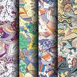 Reeks tracery kleurrijke naadloze patronen Gebogen doodling achtergronden voor textiel of druk met mehndi en etnische motieven Royalty-vrije Stock Foto's