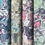 Reeks tracery kleurrijke naadloze patronen Gebogen doodling achtergronden voor textiel of druk met mehndi en etnische motieven Royalty-vrije Stock Afbeeldingen