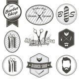 Reeks uitstekende emblemen van de kapperswinkel, etiket, kentekens Royalty-vrije Stock Foto's