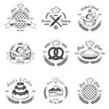 Reeks uitstekende zwart-witte bakkerijemblemen royalty-vrije illustratie