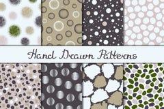 Reeks van acht naadloze texturen Patronen met gebieden, ronde en ovale elementen en vlekken Abstracte vormen getrokken een brede  stock illustratie