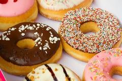 Reeks van   donuts in doos Stock Afbeelding