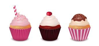Reeks van drie cupcakes Stock Afbeeldingen