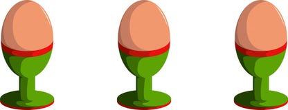 Reeks van drie eieren in eierdopjehouders Royalty-vrije Stock Foto