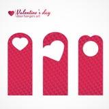 Reeks van drie hangers van de valentijnskaartendag als thema gehade deur Stock Foto