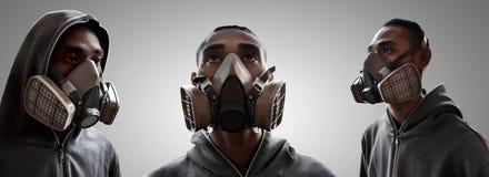 Reeks van graffitikunstenaar die gasmasker dragen Royalty-vrije Stock Afbeeldingen