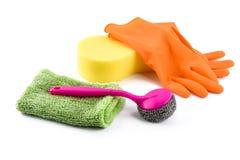Reeks van het schoonmaken van levering en handschoenen op wit wordt geïsoleerd dat Stock Foto's