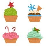 Reeks van Kerstmis cupcakes Vector Illustratie