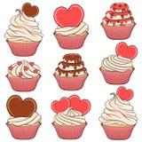Reeks van kleurenvector cupcakes met harten Stock Foto's