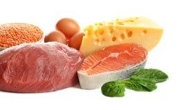 Reeks van natuurvoeding hoog in proteïne op wit stock foto