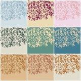 Reeks van negen uitstekende bloemenachtergronden Royalty-vrije Stock Afbeelding
