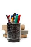 Reeks van pennen en een stapel van boeken Stock Afbeelding