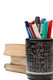 Reeks van pennen en een stapel van boeken Stock Foto