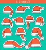 Reeks van sticker Santa Claus van 12 de rode krabbelhoeden Royalty-vrije Stock Afbeelding