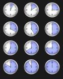 Reeks van twaalf alarm die op verschillende tijden wijzen Royalty-vrije Stock Foto's