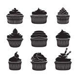 Reeks van vector cupcakes Stock Afbeeldingen