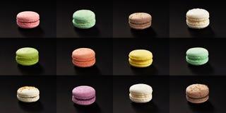 Reeks van vele multicolored macaroni Heerlijke die makarons op zwarte achtergrond worden geïsoleerd Frans zoet koekje Royalty-vrije Stock Foto